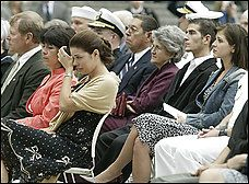Surrounded by members of her husband's family, Patsy Dietz, widow of Danny Dietz, wipes her eye during the awarding of the Navy Cross to her husband during a service at the U.S. Navy Memorial.