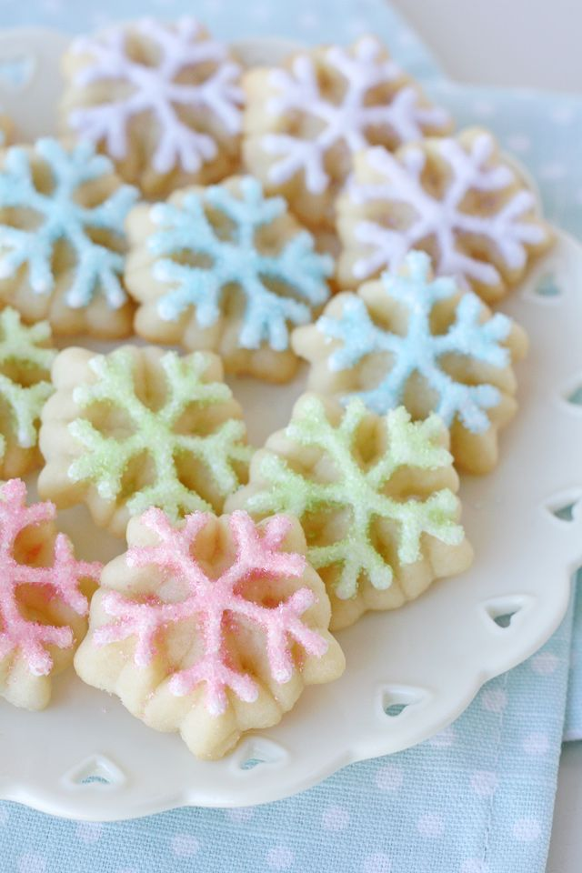 Delicious and cute Spritz Snowflake Cookies! The perfect spritz cookie recipe and all the tips you need to make beautiful snowflake cookies!