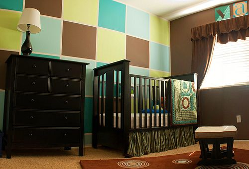 Love the wall...no nursery for me, but this may be a way to tie in the kids favorite colors in their room!