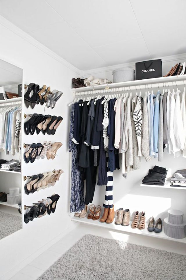 Utilizing towel bars as shoe racks makes for a simple yet chic way to show off your best footwear. When styled with streamlined shelves, it adds the perfect amount of minimalism to your closet.      - HarpersBAZAAR.com