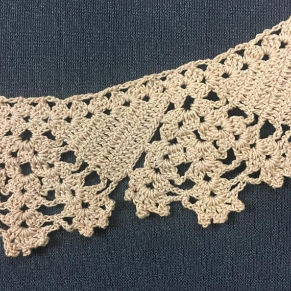 This is a strip of beautiful vintage handmade crochet lace in a beige color. It is made with cotton thread.  The lace is in a triangle pattern with alternating floral sections and a nice diamond edge using 100% cotton thread. The lace is in excellent condition. This piece of lace measures bout 1 and 7/8 inch wide and is about 50 inches long or 1 yard and 14 inches.  Be sure to check out all the other Fabric, Vintage linens , Vintage Clothing and aprons I have listed in my shop.  To Get B...