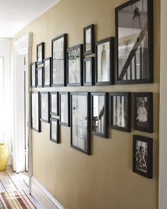 Mark a horizontal midline on the wall, and hang all pictures above or below it.   To unify the group, choose a single color for all frames and, if displaying photographs, stick with either all black-and-white or all color shots.  Clever!