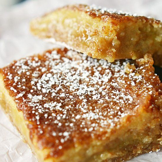 Gooey crack pie bars baked with creamy eggnog and a buttery oatmeal cookie crust.