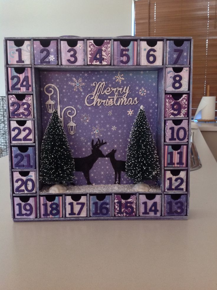 Kaisercraft advent calender 2014.   I'm so happy the way this turned out!  I went with purple, white, silver and blue hues for a colour scheme. I'm so looking forward to decorating our house. It's our first Christmas in our first home. I've also done a blue tone one for my mum.