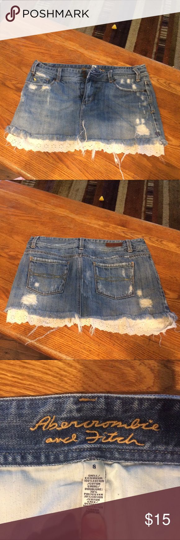 Abercrombie and Fitch distressed denim skirt. Distressed denim skirt with ruffle at bottom. Abercrombie & Fitch Skirts