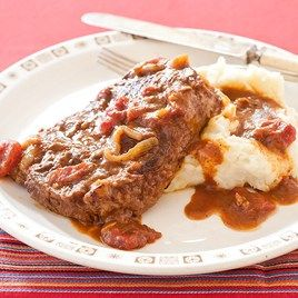 Swiss Steak with Tomato Gravy - Recipe and video instruction by Cook's Country.  I tried it & it turned out really good. My store doesn't sell blade roasts so I used regular chuck roast to get my steaks.