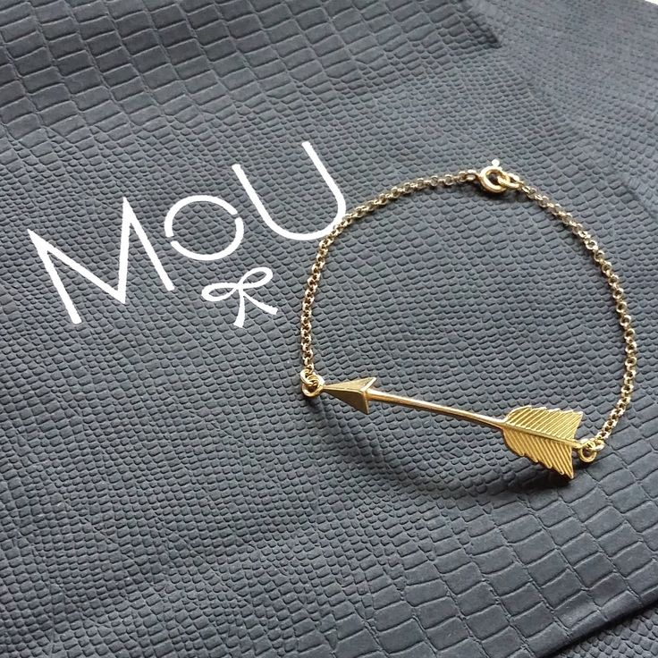 Gold plated arrow bracelet in minimal boho style by MOU