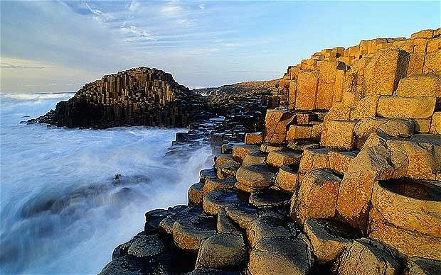 Giant's Causeway, Ireland's most popular attraction, was declared a World Heritage Site in 1986. This protected landmark is a cluster of nearly 37,000 black basalt columns in geometric shapes, formed from a mass of molten lava that spilled onto the Earth's surface during the Palaeogene period.  Picture : Alamy