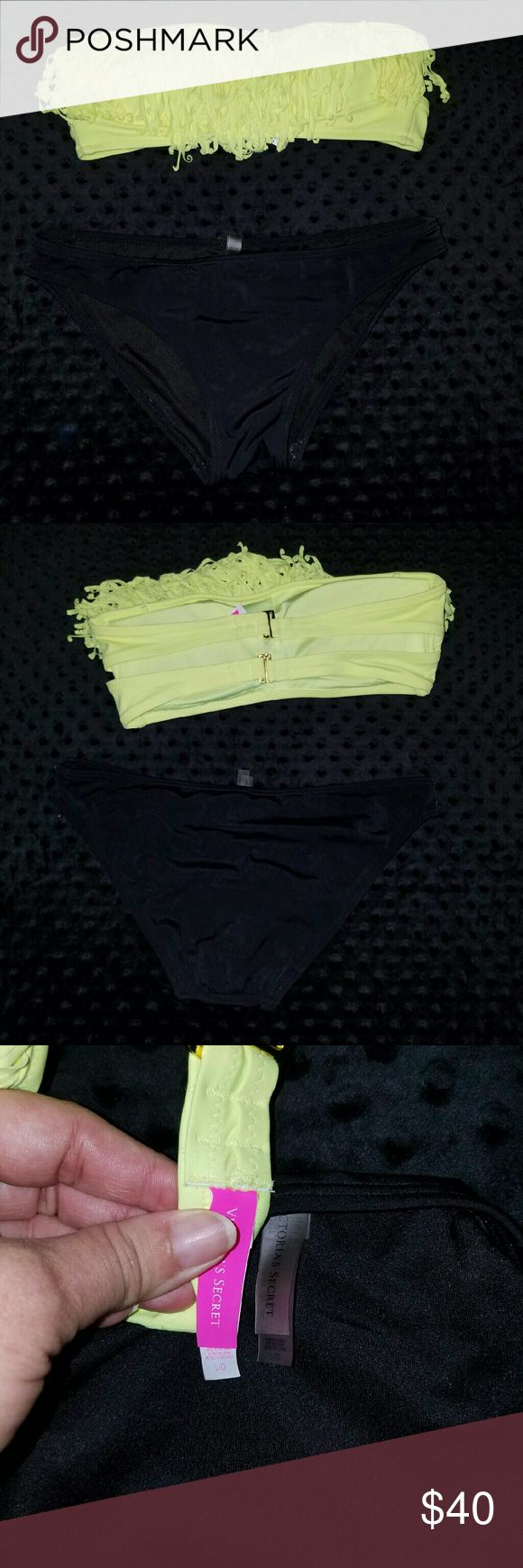 Victoria secret bikini Neon yellow bandeau top and black bottom, worn twice bottom has some piling seen in photo. Neck ties missing Victoria's Secret Swim Bikinis