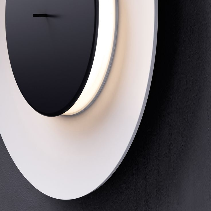 Lunaire (lighting): Wall lamp. Reflector and front disc in painted aluminium. Diffuser in clear sandblasted methacrylate. Available in two different colours: reflector and front disc in white or white reflector and black front disc. (designer: Ferréol Babin | 2013) - More @ www.fontanaarte.com #fontanaarte #light #lamp