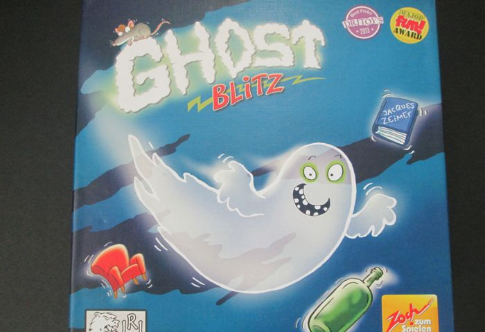 Ghost Blitz is a game of quick reflexes and puzzle solving where you have to be the first to grab the right playing piece based off of a puzzle.