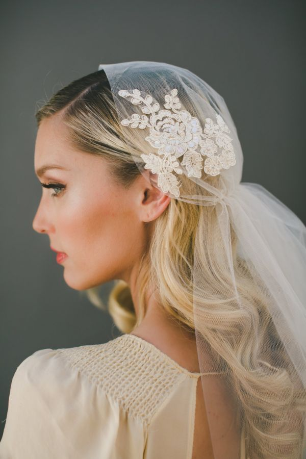 Handmade out of champagne-colored illusion tulle, this lightly elegant Juliet cap veil gathers in the back and features a subtle Alençon lace appliqué for added interest. | Photo by Abbi Cooley
