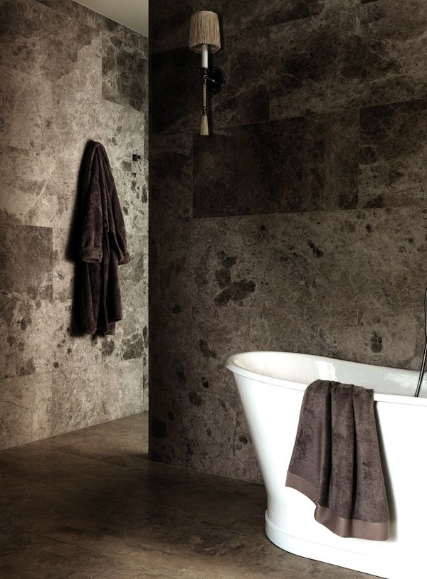 Add warmth and value to your bathroom with natural stone interiors