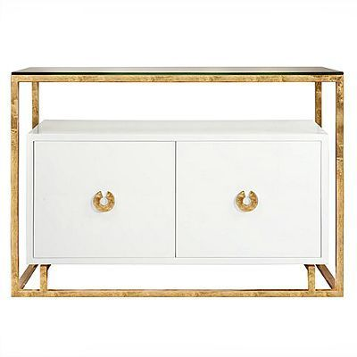 Worlds Away presents the versatile Juno Cabinet featuring a gold leaf frame supporting a white lacquer compartment which creates a unique