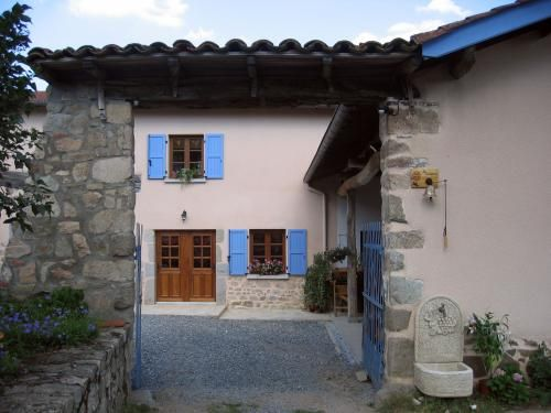 The farmhouse with blue shutters