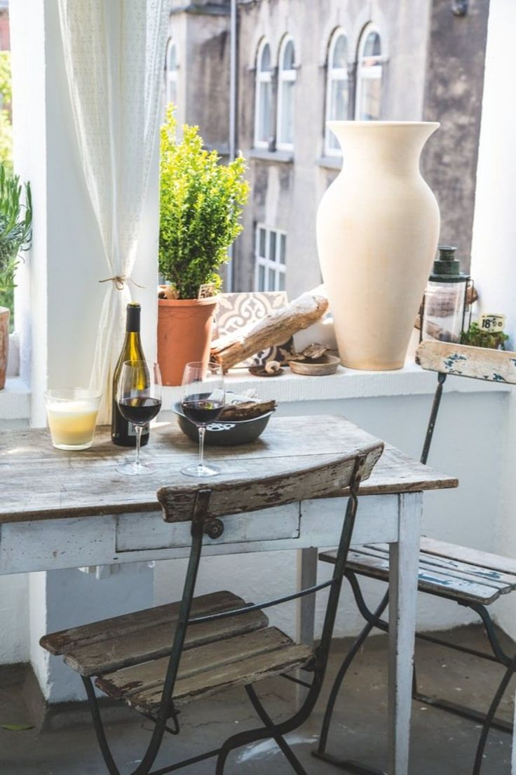 The balcony is decorated with some new and some old elements - a great combination which sets a nice atmosphere.
