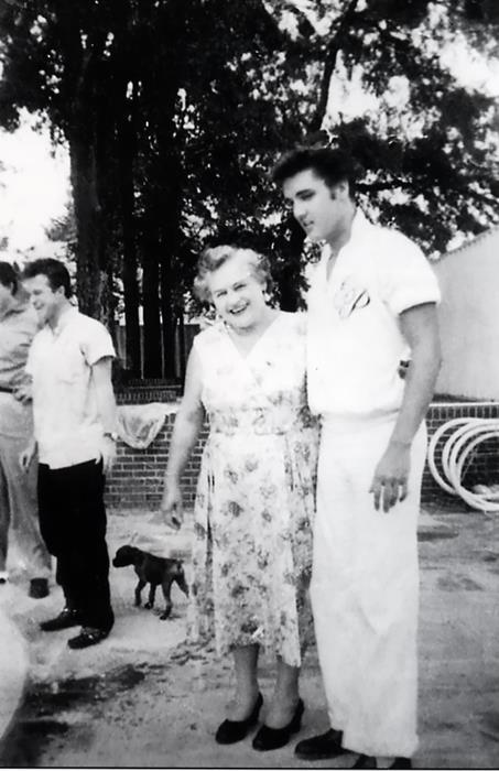 "{*Elvis Memphis, TN, Friday August 9, 1957 Actor Nick Adams (""Rebel Without a Cause"") & his mother, Catherine Adamshock (neé Kutz, April 17, 1010 – March 1995), visit Elvis & his parents at Graceland. Elvis wearing his monogrammed shirt & Nick's mom Catherine Adamshock are pictured by the pool*}"