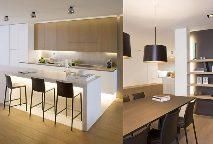 White and wood kitchen. Love the white floor in the cooking area. Might have to steal that idea;)