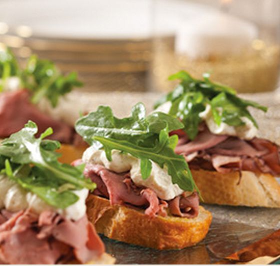 crostini three ways: - roast beef, garlic horseradish cream sauce, cream cheese, arugula  - goat cheese with pickled pimento pepper rings with homemade pepper jelly in center  - brie, turkey and grand marnier cranberry sauce