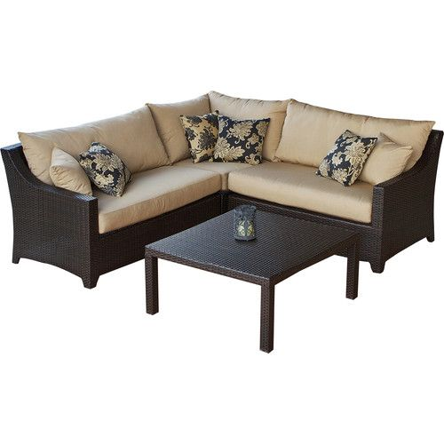 ecofriendly outdoor seating group with overstuffed sun sharp accent pillows and cushioning includes a sectional sofa and coffee tabl