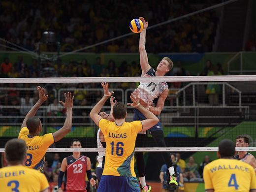 United States middle blocker Maxwell Holt hits the