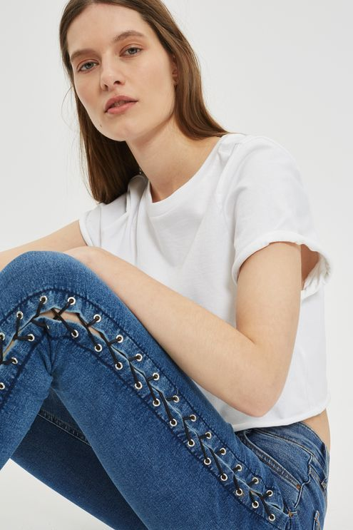 MOTO High rise, ankle grazing skinny jeans in mid blue power stretch denim with black lace up detail.