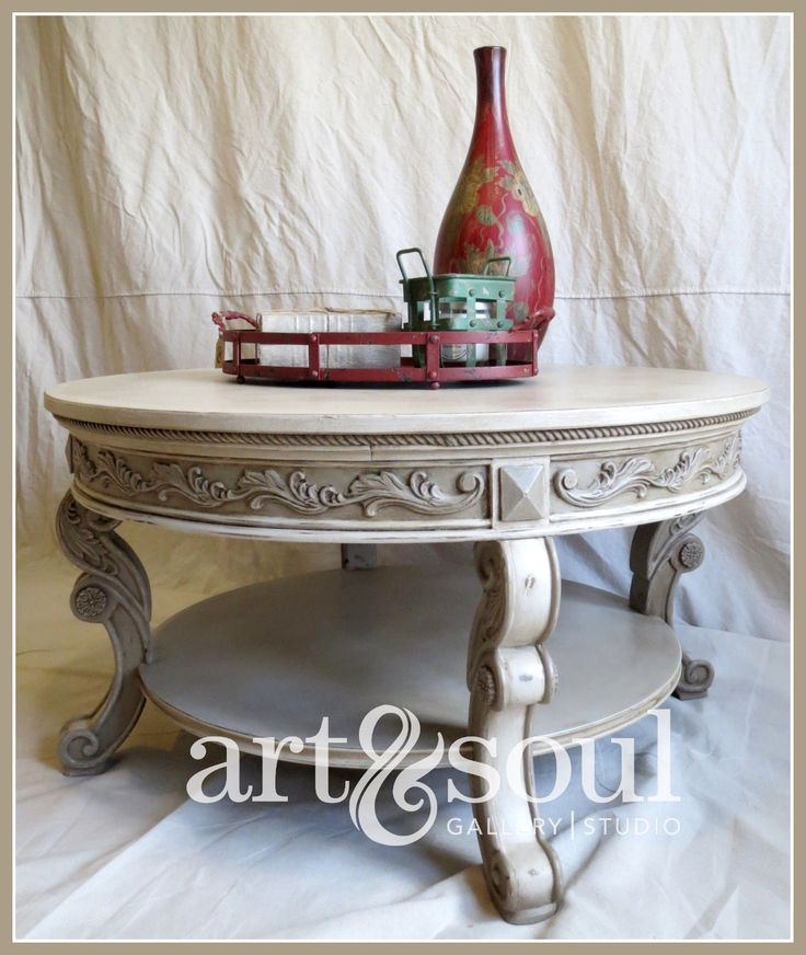 Restored coffee table done in a 50/50 mix of Pure White and Coco Chalk Paint® by Annie Sloan finished with a Dark Soft Wax glaze.