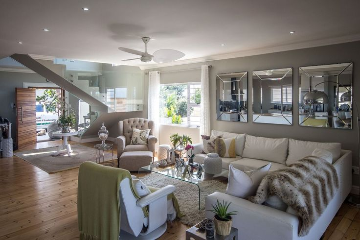Living spaces require various levels of lighting namely, accent lighting, task lighting & general lighting. This living room speaks volumes with a ceiling fan, downlights and floor lamp to pull the look together.