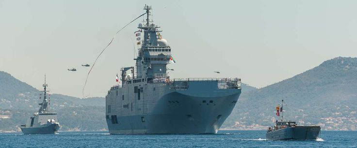French Marine Nationale BPC* Mistral and FLF* La Fayette return to home port of Toulon, 17 July 2014, after 4 months deployment on operation Jeanne d'Arc, training with multiple countries navies and armed forces. *BPC - Baitement de Projection et Commandement - equivalent to LPD amphibious assault helicopter carriers. LFL* - Frégate Légère Furtive - light stealth frigate.