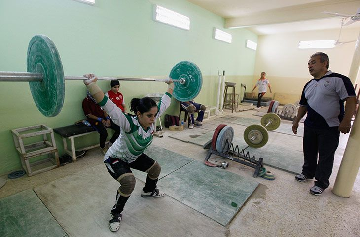 An Iraqi weightlifter lifts a loaded barbell during a training session at a gym in Sadr city in Baghdad. In this Shiite neighbourhood in the Iraqi capital Baghdad, eight women from Iraqs first female weightlifting team train hard to bring back medals for their country. The team of female weightlifters are set to represent Iraq in the Asian Championship in Qatar next monthPhotograph: Mohammed Ameen/Reuters