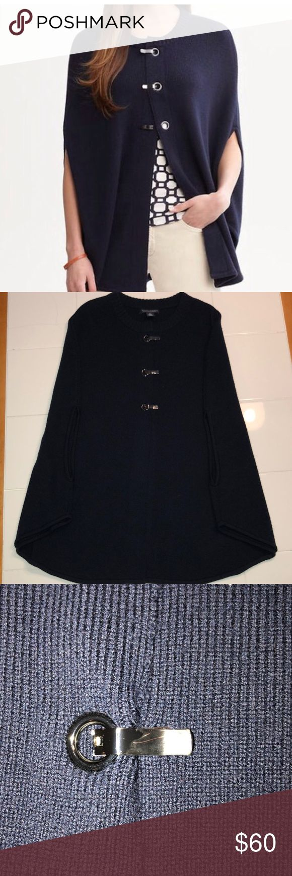 NWOT Banana Republic Navy Cape Poncho Navy extra fine merino wool cape sweater with gunmetal grommets with protective plastic still on. Never been worn. Banana Republic Sweaters Shrugs & Ponchos