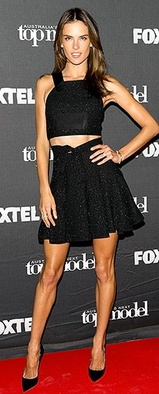 Alessandra Ambrosio flaunted her toned tummy in an ebony crop top and matching skirt teamed with pointed black heels.