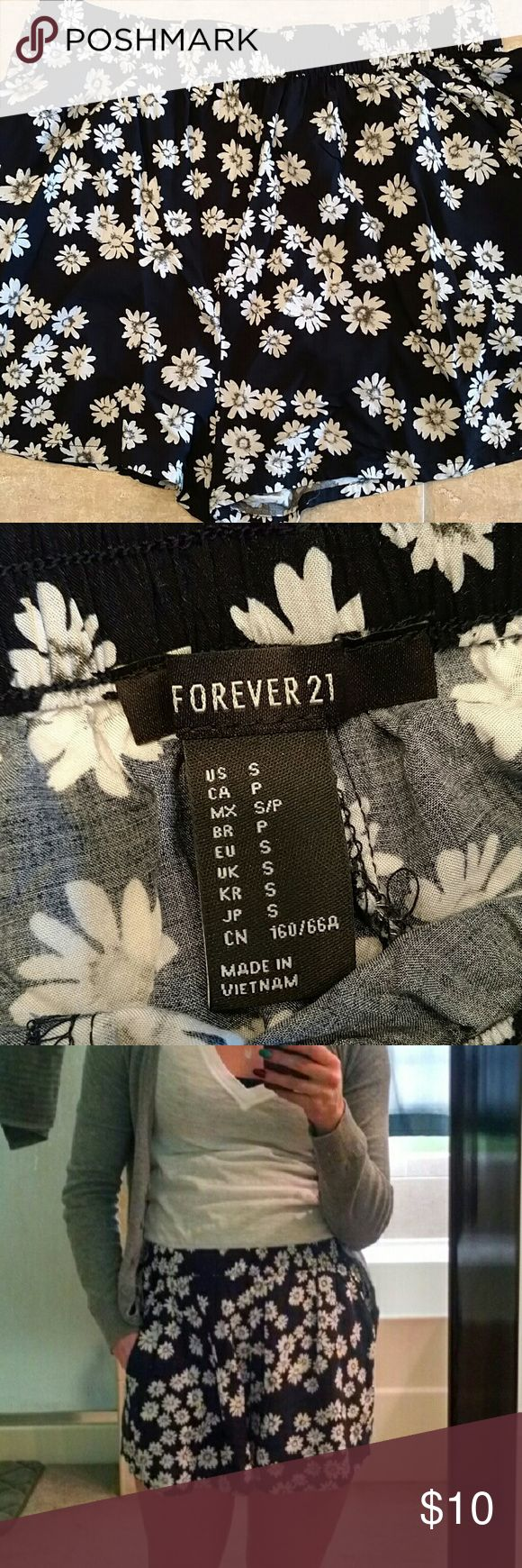 Forever 21 Daisy Shorts White daisies and dark blue. Only wore a couple times. Not my style. Forever 21 Shorts