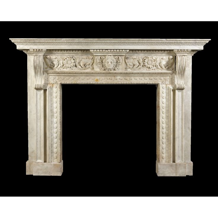 A George II carved white marble chimneypiece circa 1735, the design attributed to William Kent