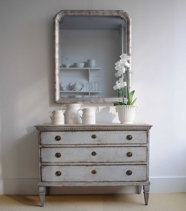 Gray dresser perfect for a sofa table