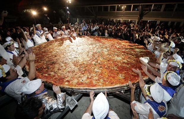The world's biggest pizza in Italy measuring 5m and 19cm in diameter and weighing in at 24kg!
