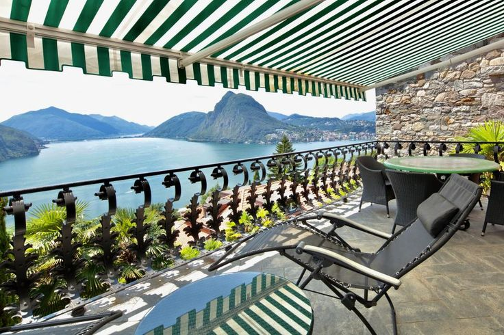 Lake Lugano in Ruvigliana, Switzerland, is the stunning backdrop to this colorful Mediterranean-style estate. Sliding-glass doors make it easy to open the house to the outdoors, while a balcony overlooking the lake makes for a perfect spot for relaxing or dining alfresco.