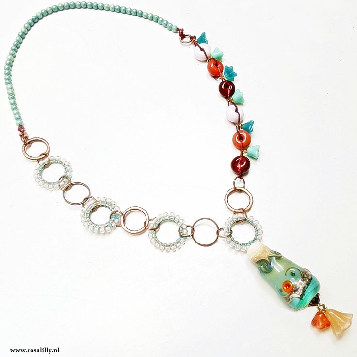 Handmade necklace with lampwork glass focal pendant lampwork beads, Czech beads, copper (beaded) rings.