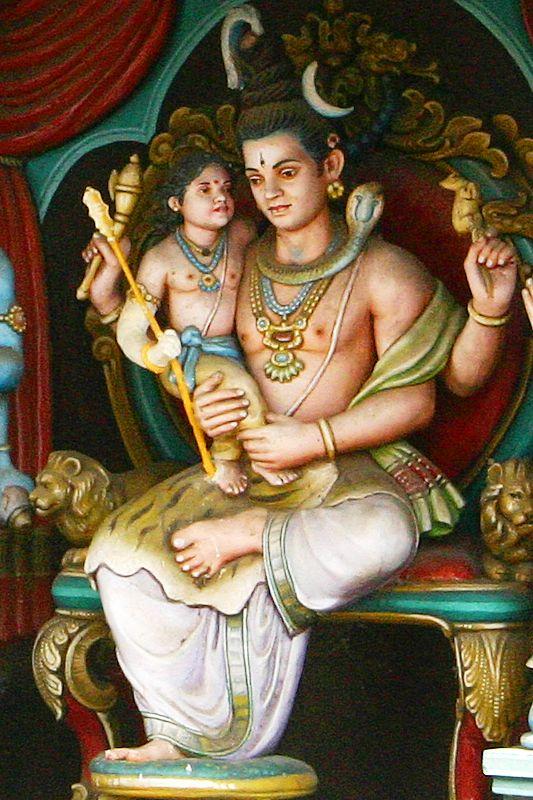 Pranava mantra, Swamimalai temple, Kumbakonam. The son Subrahmanya teaching the 'AUM' Mantra to the father, Lord Shiva.