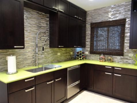 Lime green countertops combined with black cabinets and metallic tile backsplash create a eclectic kitchen, as seen on DIY Network's Kitchen Crashers.