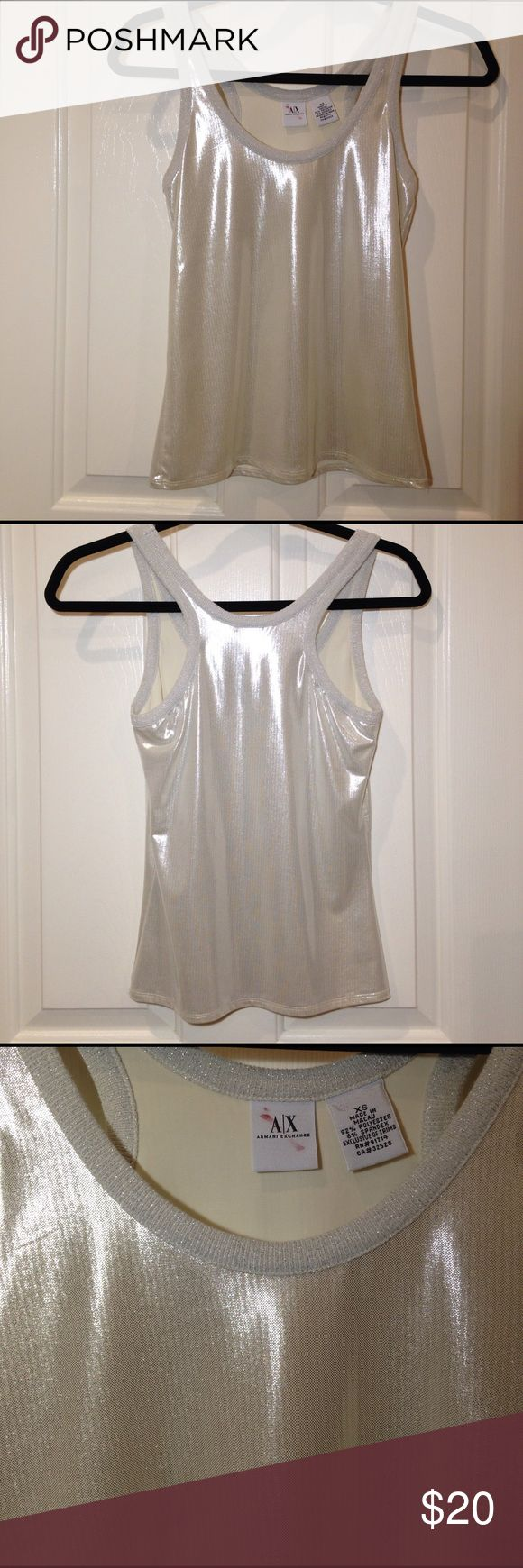 ARMANI EXCHANGE TOP SILVER XS ARMANI EXCHANGE shimmering silver racerback tank top. Light and soft fabric. Silver shimmers in the light. Great for parties and ladies lunches 🎀💄💅🏼 Armani Exchange Tops Tank Tops