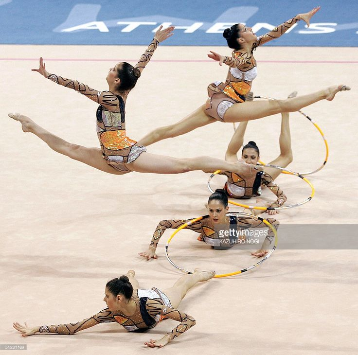 Spain's team performs with balls and hoops at the gymnastics rhythmic group all-around final, 28 August 2004, at the Galatsi Olympic Hall during the Athens 2004 Olympics Games. Spanish team took the 7th place and Russia won the event with a total score 51.100 points. AFP PHOTO / Kazuhiro NOGI