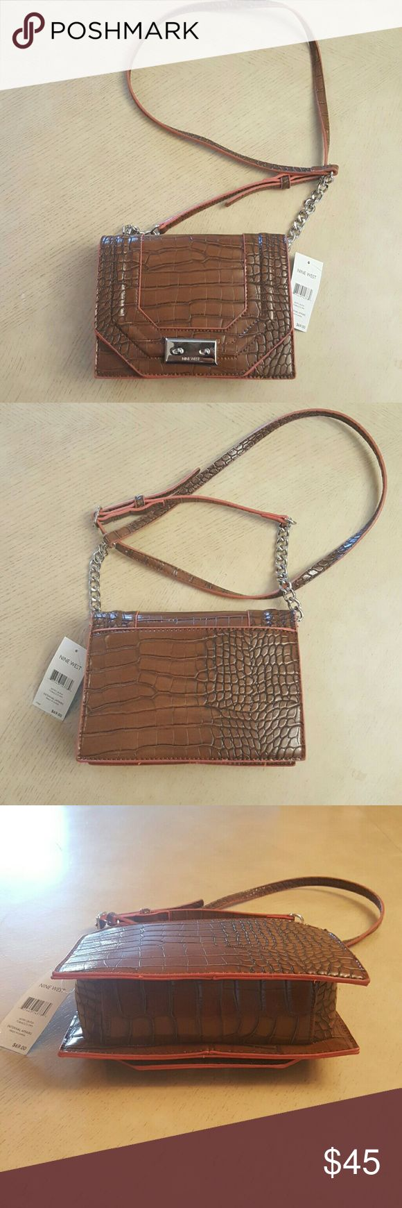 NWT Nine West Internal Affairs Crossbody NWT Nine West Internal Affairs tobacco crossbody. Never been used has original  $69 store tags. Nine West Bags Crossbody Bags