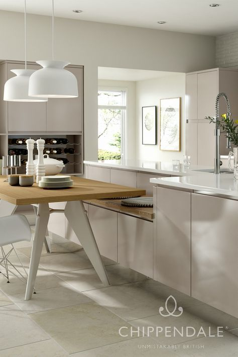 A truly modern kitchen in a subtle gloss cashmere finish. This design features integrated handles and an island that incorporates a modern dining table. For more kitchens, please see http://www.chippendalekitchens.co.uk/kitchens