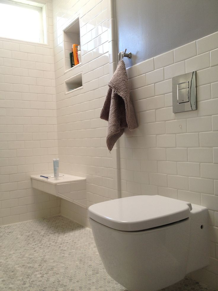 Wall mounted Maribelle toilet with chrome wall push plate  White subway tile  covers the shower. 85 best Bathroom images on Pinterest   Bathroom ideas  Bathroom