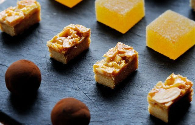 Almond biscuits (a Florentine mix on a Pate Sable base/crust). Serve as Petit Four, cut in rectangles)