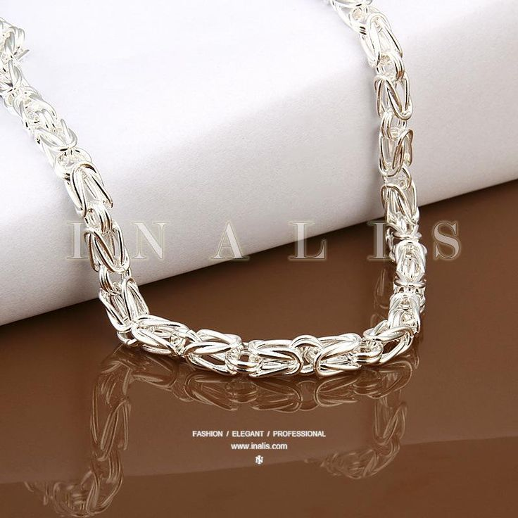 bulky silver squiggle necklace