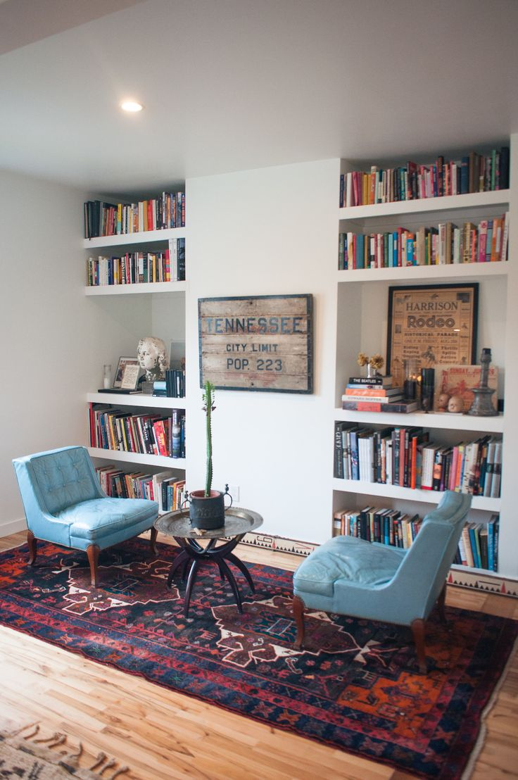 Facing chairs in front of the bookshelves.