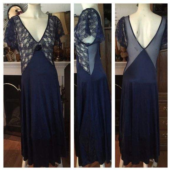 """Vintage VAL MODE Navy Lace Nightgown This vintage Val Mode navy lace nightgown is gorgeous! Sexy deep dip in front and back. Front is done in exquisite navy lace and scalloped-edge flutter sleeves. The back is done in a sheer navy nylon. Size Small. Measured flat (has stretchy give): 16"""" across top, 14-1/2"""" across chest under arms; 13"""" across waist; 48"""" across bottom; 52"""" from top of shoulder to bottom hem. 100% nylon. Made in USA. Smoke-free home. In excellent preowned vintage condition…"""