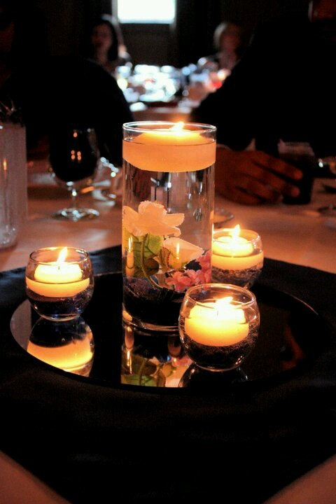 Floating candle centerpiece maybe with orange orchid - Candle and mirror centerpieces ...